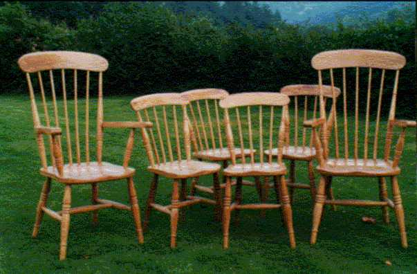 A set of Comb Back Winddsorchairs in Oak